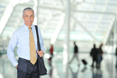 middle-aged-business-traveler-airport-9030601